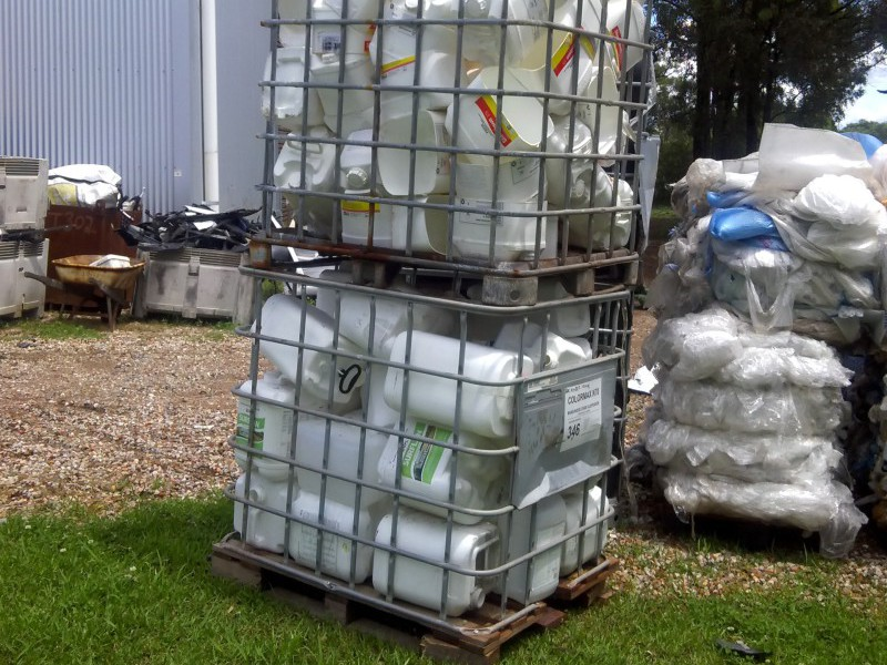 Empty chemical drums in an intermediate bulk container
