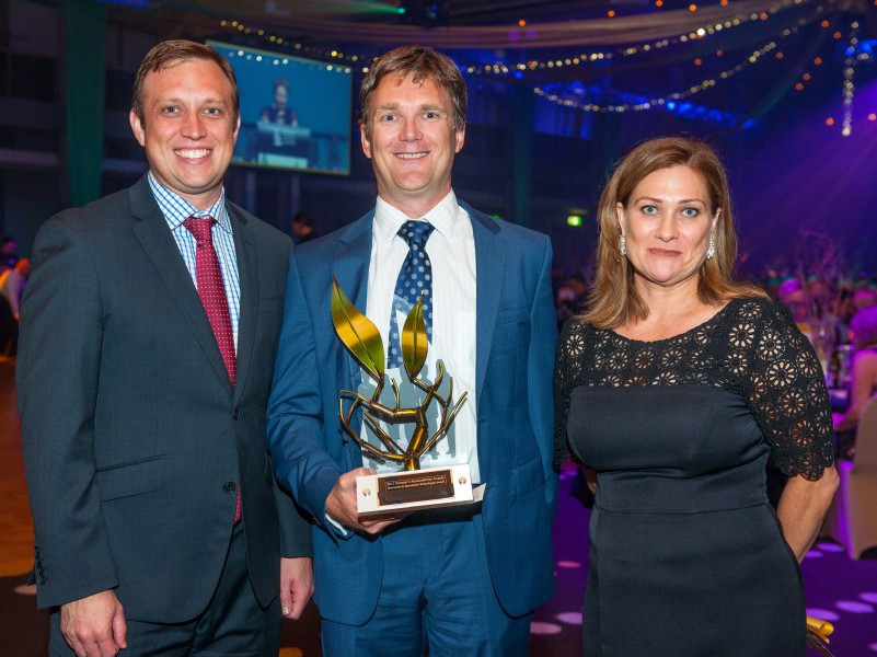 Southern Oil CEO Tim Rose collects award from Dr Steven Miles and Karen Fitzgibbon