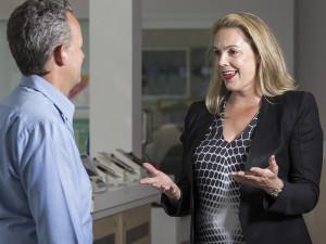 Infoactiv's Helen Jarman (r) with a Telstra Business Centre employee