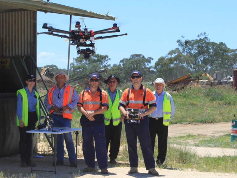 Image MediaRelease WastePlanoftoaFlyingStart 15January2016 Above: L-R GHD's Alison Horlyck and Reinhard Wilkes, Matt Holmes (Airsight Australia), Graham Bendeich (Inverell Shire Council), Matt Brice (Airsight Australia) and Phil Sutton (Inverell Shire Council) watch on as the drone returns after an aerial survey Inverell Shire Council
