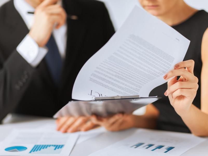 Business people reviewing documents