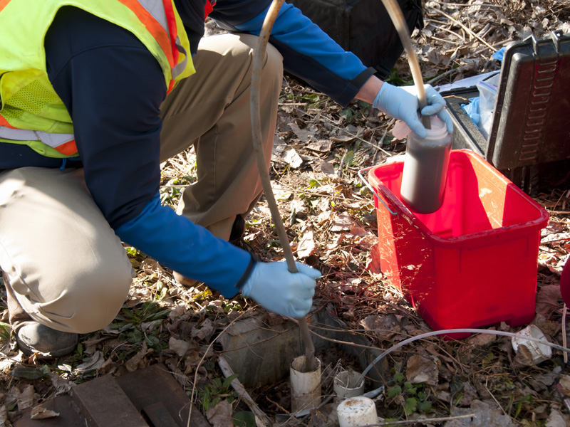 Testing water quality near a waste site