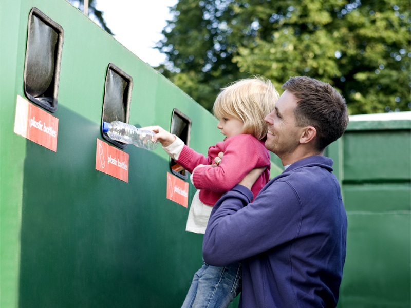 A father embraces recycling education with his child