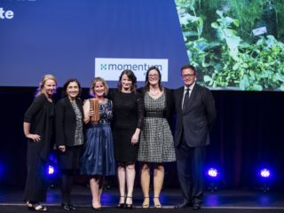 Louise Ward and her team from Yarra Valley Estate accept their Sustainability Award for the Small & Medium Enterprises category from VIC Environment Minister Lily D'Ambrosio