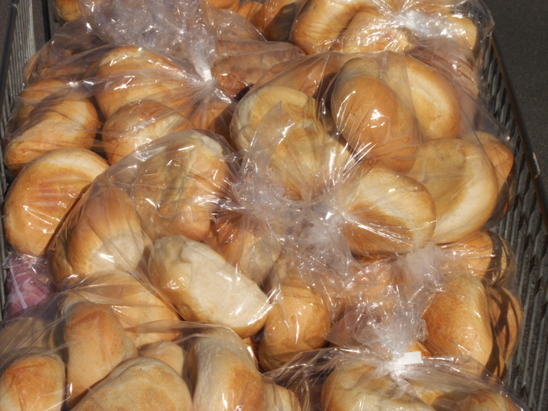 Scores of bags of bread rolls for the bin can be redistributed through food rescue charities.
