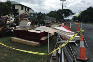 Household waste piles up as a result of flash flooding at Drapers Siding in Mackay, Queensland.