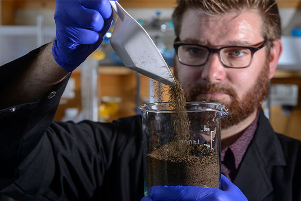 Waste sulfur polymers to assist plastic recycling